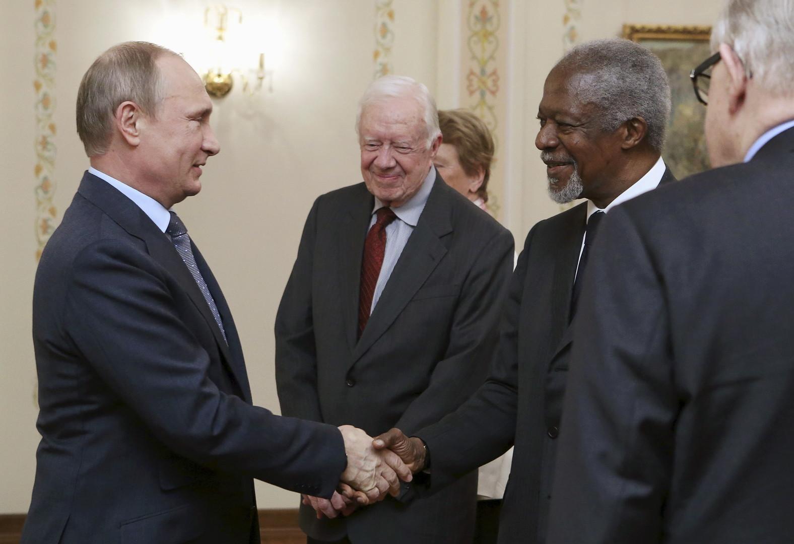 Vladimir Poutine, Jimmy Carter et Kofi Annan