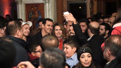 Bachar et Asma el-Assad en visite à l'église Notre-Dame de Damas