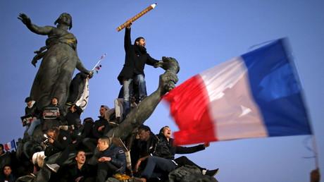 Des participants à la marche de solidarité après les attentats de Charlie Hebdo à Paris