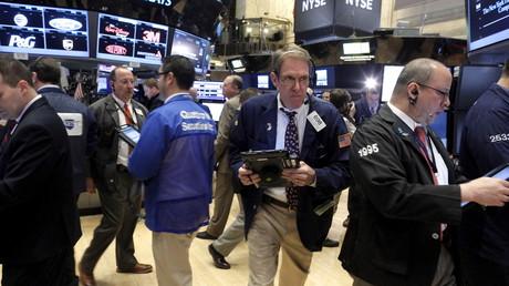 Les traders travaillent dans une salle du New York Stock Exchange le 7 janvier dernier