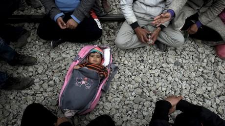 Des réfugiés à la frontière de la Grèce et de la Macédoine