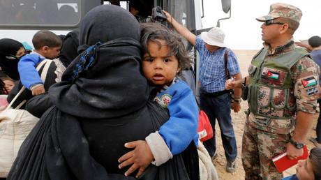 Des réfugiés à la frontière syro-jordanienne