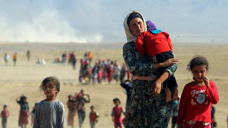 Populations yézidies fuyant la ville de Sinjar, prise par l'Etat Islamique. Août 2014.