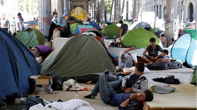 Sondage sur les migrants - Page 2 57ac393fc46188106e8b4634