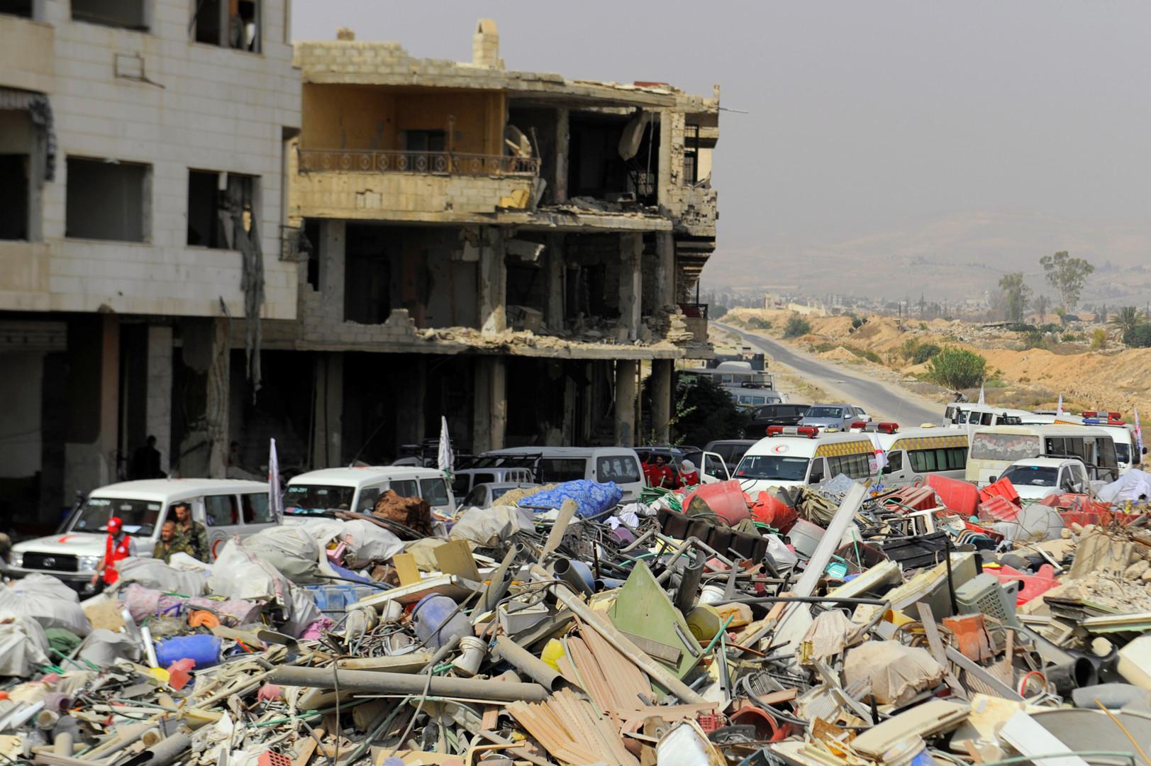 Syrie : des rebelles et leurs familles commencent à quitter la ville assiégée de Daraya