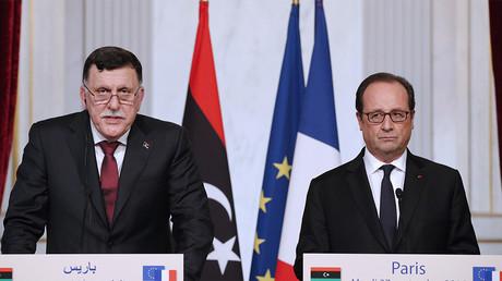 Le Premier ministre libyen Fayez al-Sarraj et François Hollande, le 27 septembre. Photo ©Yoan Valat/AFP
