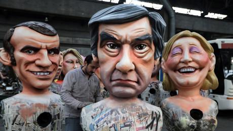 Des figurines d'Emmanuel Macron, François Fillon et Marine Le Pen lors des préparations au carnaval de Nice