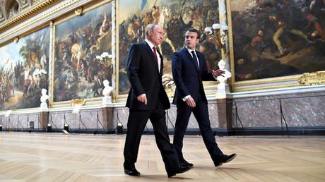 Vladimir Poutine et Emmanuel Macron.