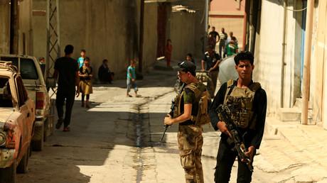 Des membres du service irakien de contre-terrorisme patrouillent dans Mossoul le 20 juillet