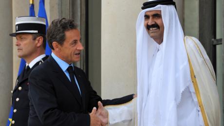 Nicolas Sarkozy et l'ancien émir du Qatar, le Cheikh Hamad ben Khalifa al-Thani en septembre 2011.