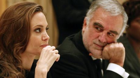 Angelina Jolie et le procureur de la Cour pénale internationale (2003-2012) lors d'un gala baptisé «Cinéma pour la paix», photo ©Fabrizio Bensch/Reuters