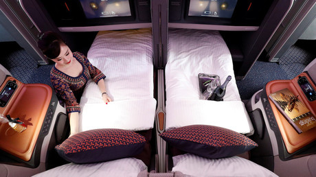 Illustration : fauteuils couchettes business class proposé par la compagnie Singapour airlines, photo ©Edgar Su/Reuters