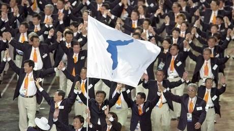 Comme en 2000 à Sydney, les deux Corées défileront ensemble sous une bannière favorable à leur réunification