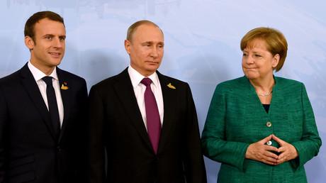 Poutine, Macron et Merkel prônent la coopération en faveur de la trêve en Syrie