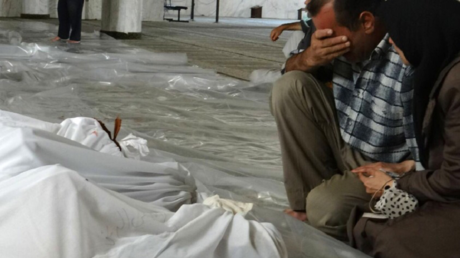 Un Syrien pleure la mort de ses proches, Image d'illustration