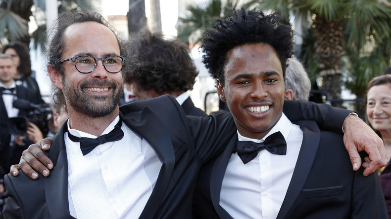 "The glamorous life of an open-borders lawbreaker: Cédric Herrou and a trophy migrant on the red carpet at the Cannes Film Festival. (You may enjoy other tragicomic pictures by searching for ""Cédric Herrou"" on Google Images.)"