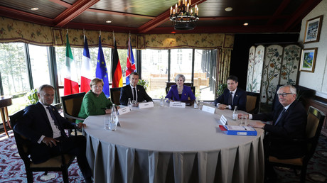 Le président du Conseil européen Donald Tusk, la chancelière allemande Angela Merkel, le président français Emmanuel Macron, le Premier ministre britannique Theresa May, le chef du gouvernement italien Giuseppe Conte et le président de la Commission européenne Jean-Claude Juncker le 8 juin 2018.