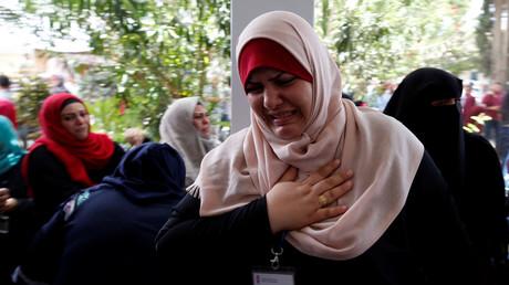 Une employée de l'UNRWA réagissant à l'annonce de l'organisation de licencier 250 personnes, à Gaza, le 25 juillet 2018