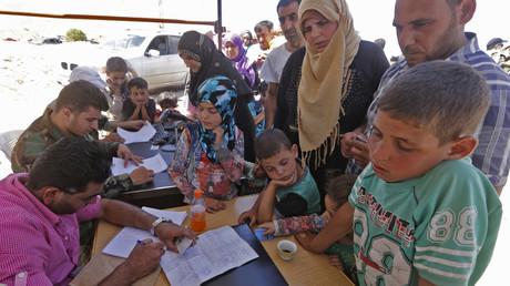 Des réfugiés revenus en Syrie après avoir quitté le pays pour le Liban, juin 2018.