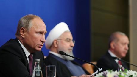 Le président russe Vladimir Poutine, le président iranien Hassan Rouhani et le président turc Recep Tayyip Erdogan assistent à une conférence de presse à l'issue de leur réunion sur la Syrie organisée à Téhéran, le 7 septembre 2018  (image d'illustration).