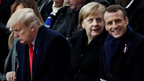 Le président français Emmanuel Macron, la chancelière allemande Angela Merkel, le président américain Donald Trump, assistent à la cérémonie commémorative du Jour de l'Armistice, à l'Arc de Triomphe à Paris, France, le 11 novembre 2018.