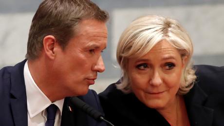 Marine Le Pen et Nicolas Dupont-Aignan, assistent à une conférence de presse à Paris, avant le second tour de l'élection présidentielle, le 29 avril 2017 (image d'illustration).