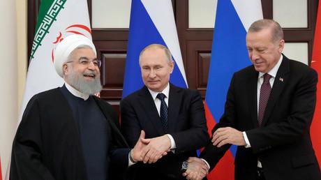 Hassan Rohani, Vladimir Poutine et Recep Tayyip Erdogan à Sotchi, le 14 février.