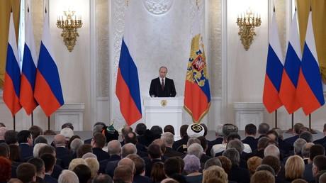 Le président russe Vladimir Poutine s'exprime sur le résultat du référendum en Crimée le 18 mars 2014, devant le Parlement russe réuni en congrès.