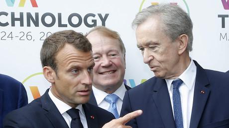 Le Français Bernard Arnault, président du groupe de luxe LVMH - ici avec Emmanuel Macron au salon du VivaTech le 24 mai 2018 - est entré en 2019 dans le trio des trois «centimilliardaires» aux côtés des Américains Jeff Bezos (Amazon) et Bill Gates (Microsoft).