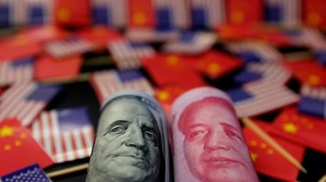 La chute du Mao Zedong face au Benjamin Franklin a-t-elle été planifiée par la Banque centrale de Chine et est-elle le prélude à une guerre des monnaies ? (illustration).