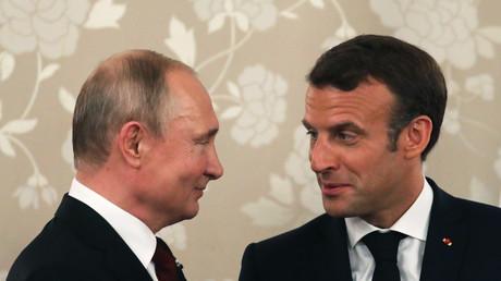 Le président russe Vladimir Poutine et son homologue français Emmanuel Macron lors du G20 à Osaka au Japon, le 28 juin.