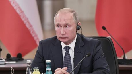 Vladimir Poutine lors de la conférence de presse avec Hassan Rohani et Recep Tayyip Erdogan à Ankara (Turquie), le 16 septembre 2019.