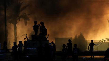 Des forces de sécurité irakiennes lors de la repression des manifestations du 2 octobre, à Bagdad.