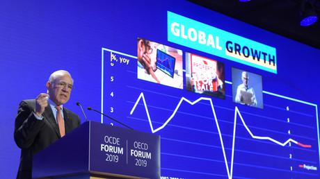 Angel Gurria, secrétaire général de l'OCDE, présente les perspectives économiques de l'OCDE au siège de l'OCDE à Paris, le 21 mai 2019.