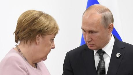 29 juin 2019. Le président russe Vladimir Poutine et la chancelière allemande Angela Merkel lors d'une réunion en marge du G20
