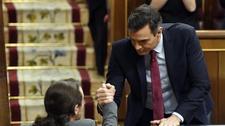 Sanchez reconduit à la tête du gouvernement espagnol, vers une coalition inédite avec Podemos