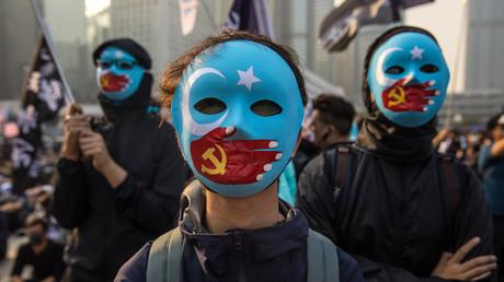 Des manifestants participent à rassemblement à Hong Kong le 22 décembre 2019 en soutien à la minorité ouïghoure de Chine (image d'illustration).