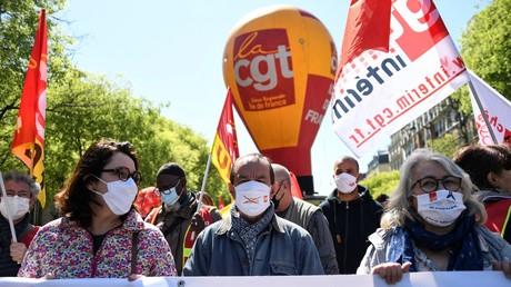 Le secrétaire général de la CGT Philippe Martinez en tête du cortège d'une manifestation contre la réforme de l'assurance chômage à Paris, le 23 avril 2021 (image d'illustration).