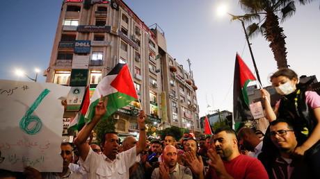Des manifestants participent à une manifestation de solidarité avec les prisonniers palestiniens dans les prisons israéliennes, à Ramallah, en Cisjordanie occupée par Israël, le 8 septembre 2021.