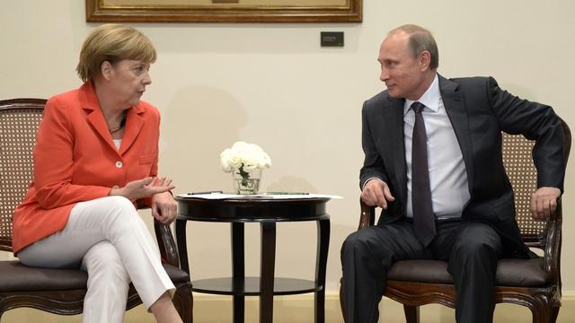 Путин и Меркель за видеоконференцию между Киевом и ополченцами