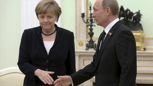 Меркель опередила Путина в рейтинге AFP