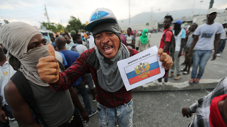 Le JDM: протестующие гаитяне жгут американские флаги и зовут Россию на помощь