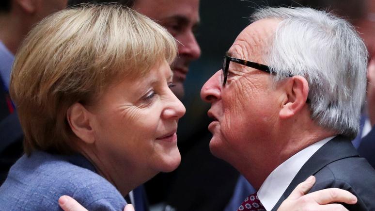 Юнкер: Меркель правильно поступила, открыв границы для мигрантов