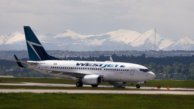 L'Express: канадский самолёт вернулся в аэропорт из-за шутки пассажира о коронавирусе
