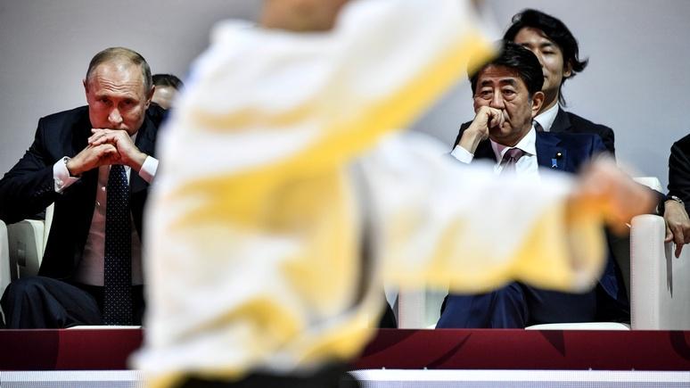 Asahi Shimbun: визит Абэ в Россию на 9 мая может подать миру «неправильный сигнал»