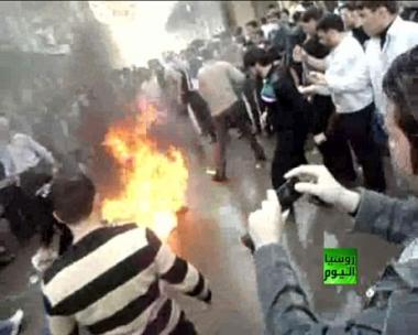 إسقاط وحرق صورة بشار الاسد