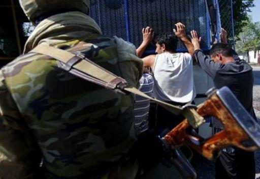 احتجاز عنصرين من مجموعة ارهابية دبرت عملية اودت بحياة 19 شخصا