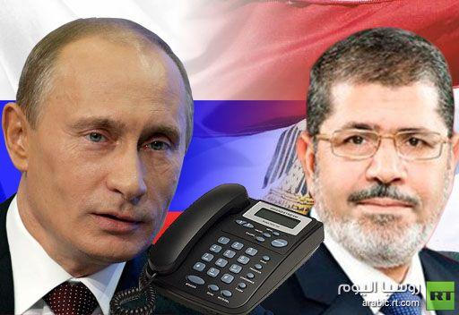 بوتين يهنئ مرسي بانتخابه رئيسا لمصر ويبحث معه الأزمة السورية