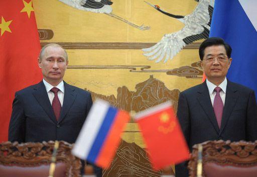 بوتين  وهو جينتاو  يعارضان التفسير التعسفي لأحكام القانون الدولي