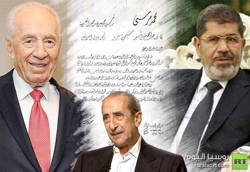 قنديل يعتذر للفلسطينيين ويطالب مرسي بتوضيح كيفية توطد علاقته بصديقه الوفي بيريز